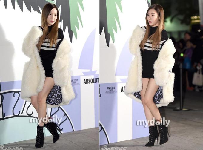 <p> Tiffany kết hợp áo khoác lông cùng áo len khi dự một show diễn hôm 17/10. Người đẹp thận trọng từng bước chân vì mặc ngắn.</p>